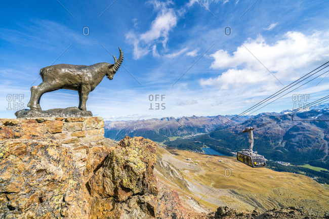 Ibex statue on rocks surrounding the cable car going up to Piz Nair, St. Moritz, Engadine, canton of Graubunden, Switzerland, Europe