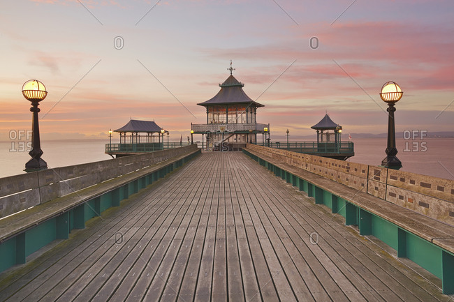 A dusk view of Clevedon Pier, in Clevedon, on the Bristol Channel coast of Somerset, England, United Kingdom, Europe