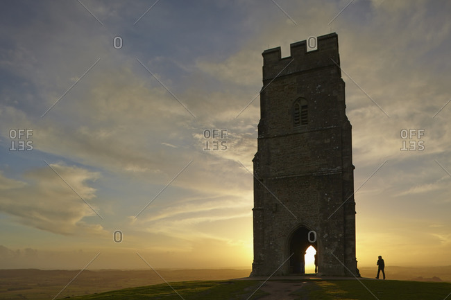 St. Michael's Tower silhouetted at sunset, on the summit of Glastonbury Tor, Glastonbury, Somerset, England, United Kingdom, Europe