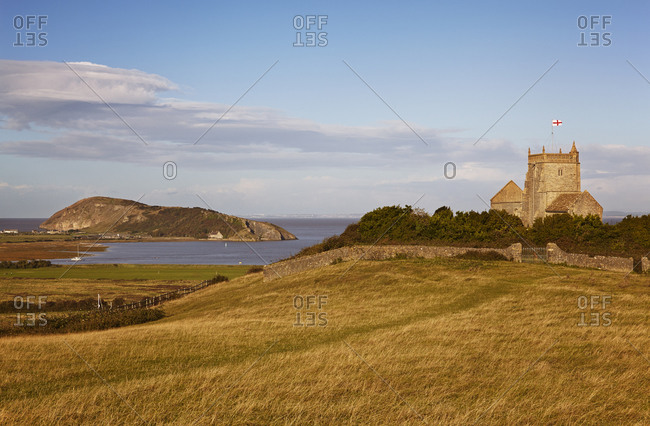 A view of St. Nicholas' Church and onward to Brean Down, from Uphill, Weston-super-Mare, on the coast of Somerset, England, United Kingdom, Europe