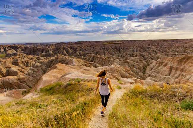 Woman hiking her way through the scenic Badlands, South Dakota, United States of America, North America