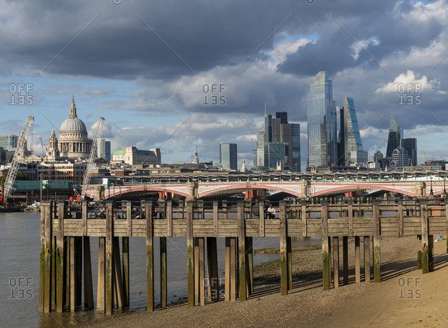 July 6, 2020: St. Pauls Cathedral and the City of London above old wooden pilings on the Southbank of the River Thames, London, England, United Kingdom, Europe