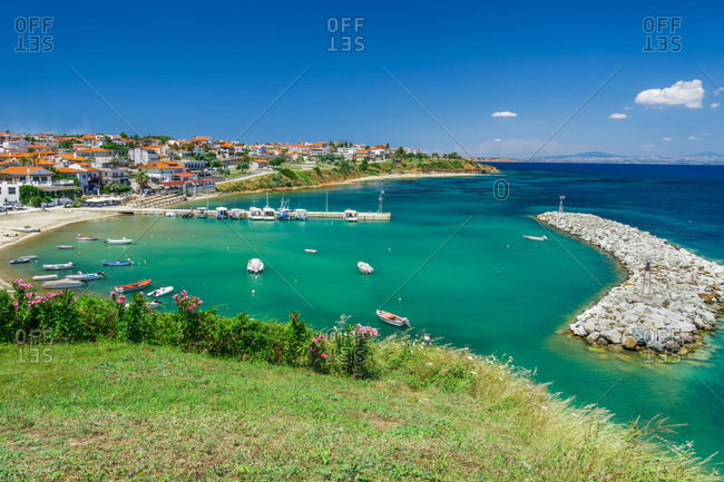 Coastal village with fishing port, hilltop view of Nea Fokaia at Kassandra peninsula with low rise buildings, Chalkidiki, Greece, Europe