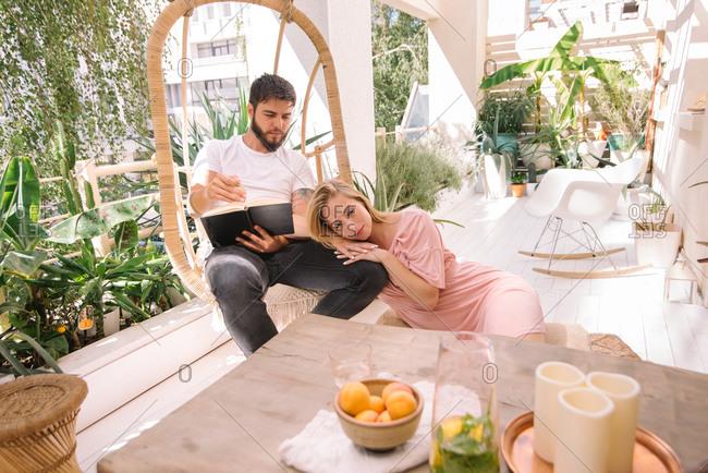 Couple spending time on their beautiful boho balcony