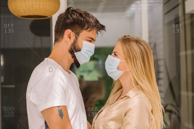 Couple wearing masks during the Covid- 19 outbreak