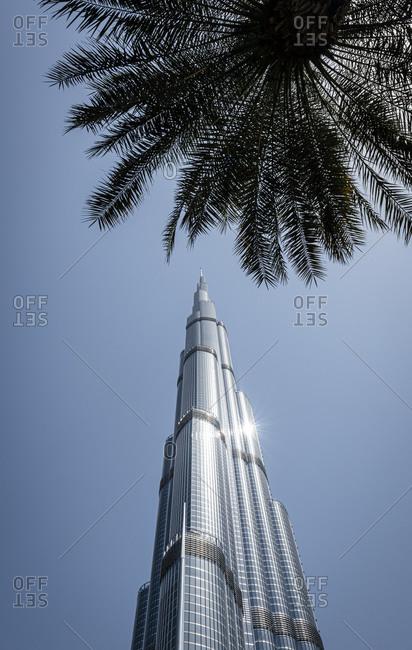 Dubai, United Arab Emirates - April 5, 2018: Low angle view of the Burj Khalifa skyscraper in the city of Dubai