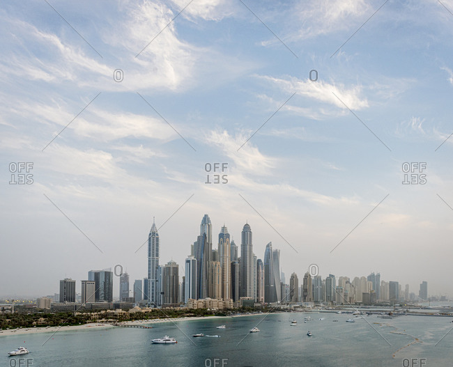Skyscrapers in the downtown skyline and boats in the harbor, Dubai, United Arab Emirates