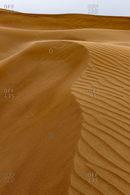 Graphical sand patters on the dunes in the desert of the United Arab Emirates