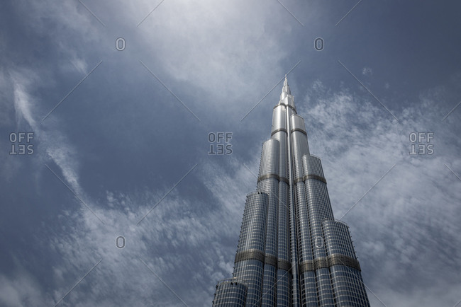 Dubai, United Arab Emirates - April 8, 2018: The Burj Khalifa skyscraper in the city of Dubai viewed from below