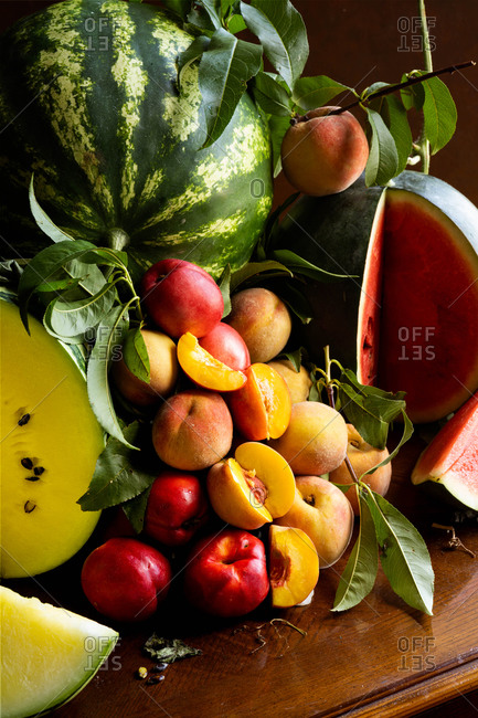 Summer Fruits - Peaches and Melon on Wooden Table