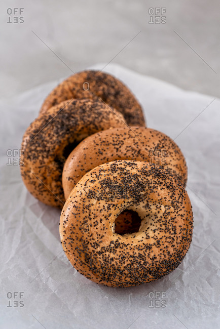 Bagels stacked on a waxed paper