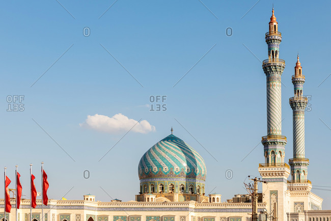 February 28, 2018: Exterior view of an oriental Mosque with decorative tiles and a dome in Qom, Iran