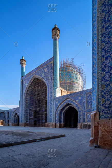 Colorful ornamental courtyard of decorated at Shah Mosque of Isfahan, Iran