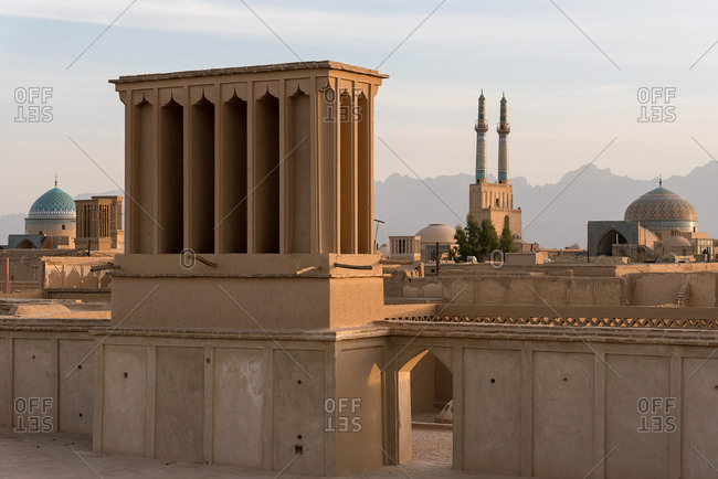 Views of the skyline with minarets and domes of Yazd at sunset, Iran