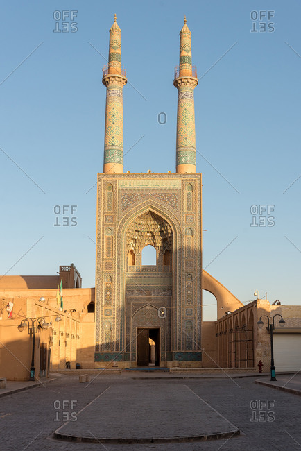 Big Mosque with tall minarets in Yazd at sunset, Iran