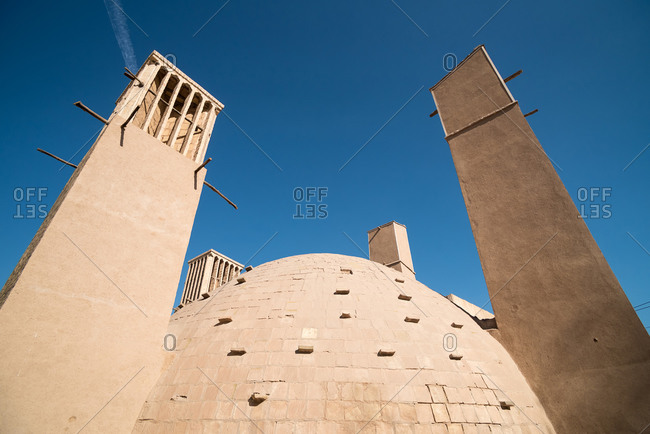 Wind towers and dome-shape Ice Chamber building in Yazd, Iran.