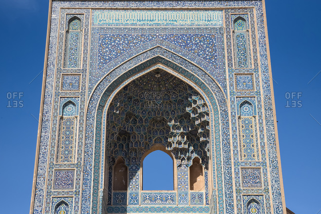 March 5, 2018: Colorful Jameh Mosque with blue ornamental mosaic in Yazd, Iran.