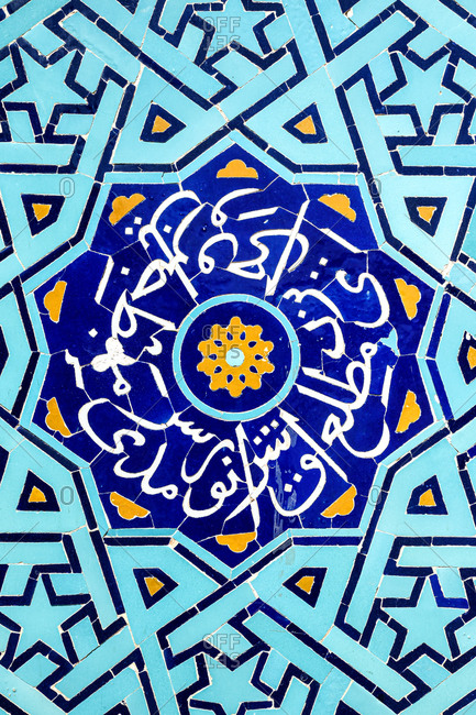 March 5, 2018: Bright blue arabian tile mosaic on a wall in Yazd, Iran