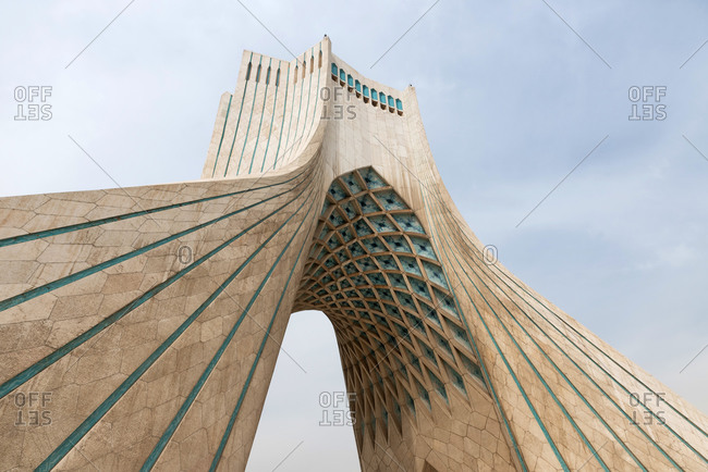 March 11, 2018: The modern Azadi tower on a gray cloudy day in Tehran, Iran