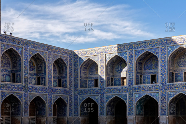 Details of the courtyard walls inside the Shah Mosque in Isfahan, Iran