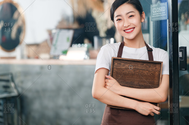 Holding a tray of coffee shop attendant