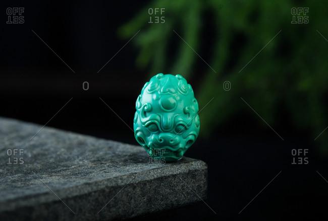 A jade pendant features close uo