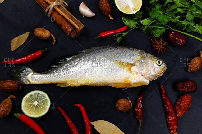 A yellow croaker set out on a platter