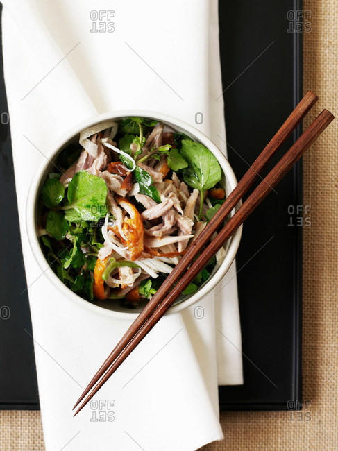 Bowl of duck and watercress salad
