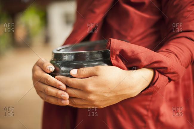 Young Buddhist Monk gathering alms, Bagan, Myanmar