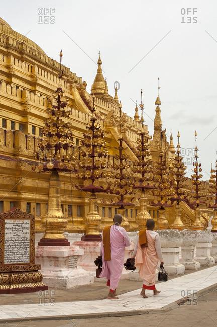 Nuns passing Shwezigon Pagoda, Bagan, Myanmar
