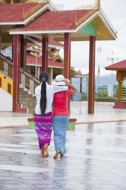 Two women walking, Inle lake, Burma