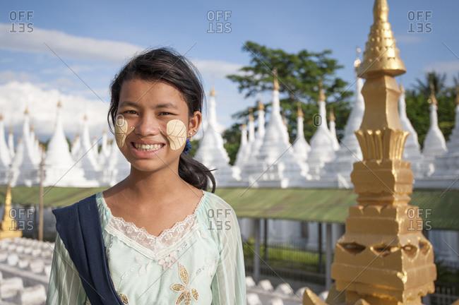 September 4, 2013: Young woman with face paint, Sanda muni pagoda, Mandalay, Burma