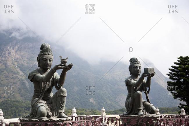 Statues presenting gifts to the Tian Tan Buddha, Ngong Ping, Lantau Island, China, Asia