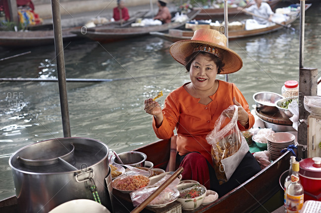 January 3, 2013: Portrait of mature female market stall holder, Damnoen Saduak Floating Market, Thailand