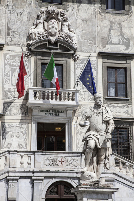 April 9, 2013: Statue and flags outside Pisa university, Pisa, Tuscany, Italy