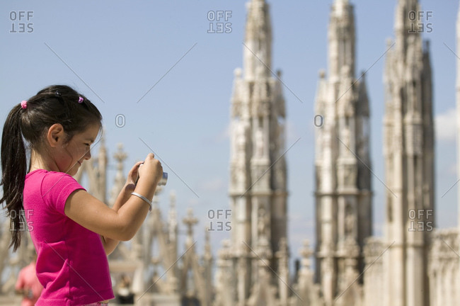 Girl photographing Milan cathedral, Milan, Lombardy, Italy