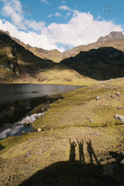Peoples shadows on ground, Lares, Peru