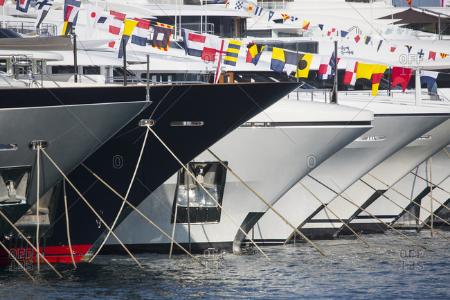 Close up of a row of luxury yachts moored in Port Hercule, Monte Carlo, Monaco