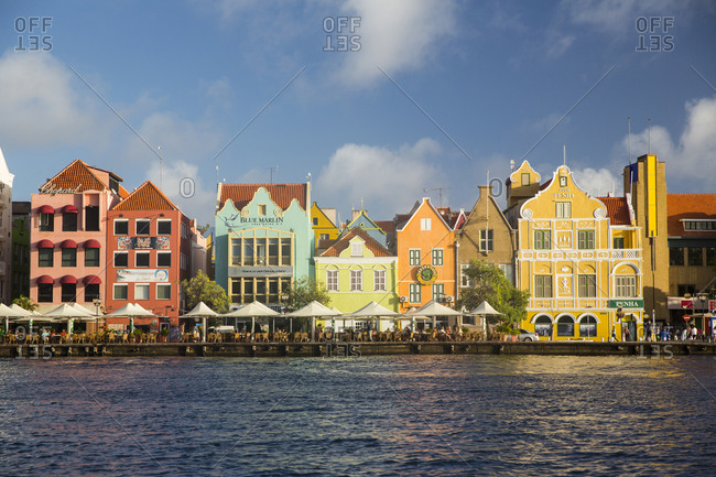 January 13, 2015: Row of traditional multi colored town houses on waterfront, Punda, Willemstad, Curacao, Caribbean