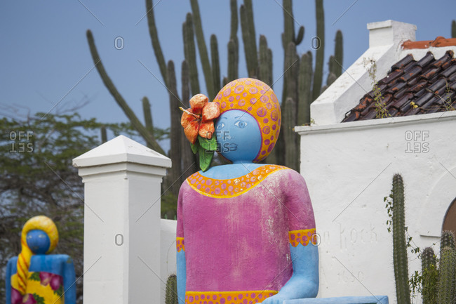 Multi colored sculptures of women, St. Willibrordus, Curacao, Caribbean