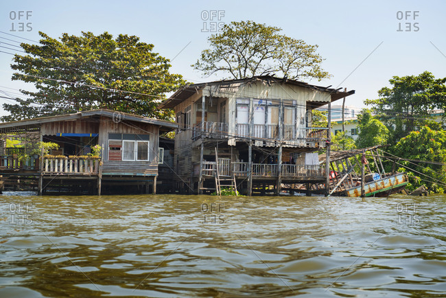 Wooden houses on river, Bangkok, Thailand