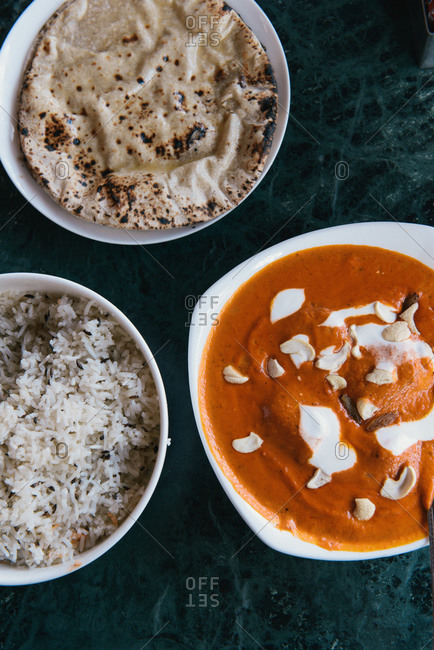 Breakfast with bowls of rice and tikka masala, Jaipur, Rajasthan, India