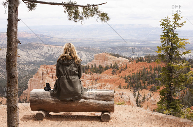 Rear view of female hiker looking out from log bench at Bryce Canyon National Park, Utah, USA