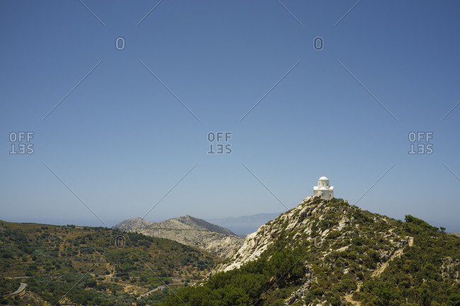 Elevated view of church perched on rural hill, Naxos Island, Greece