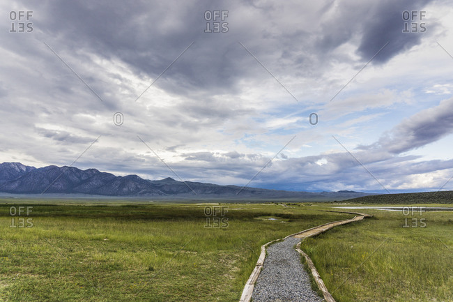 Walkway to mountain ranges, California, USA
