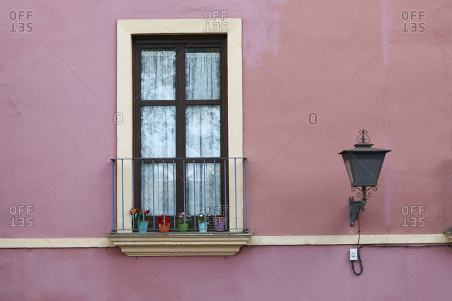 Detail of traditional pink painted house exterior, Seville, Andalusia, Spain