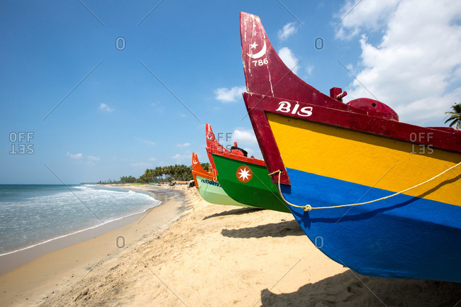 December 6, 2012: Row of colorful beached fishing boats, Varkala, Kerala, India