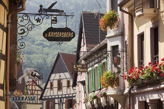 September 4, 2010: Business signage on medieval buildings, Kaysersberg, Alsace, France