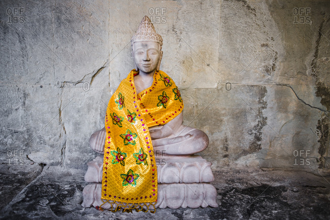 Buddhist statue with golden sash, Angkor Wat, Cambodia