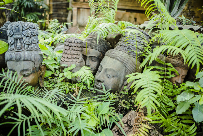 Terracotta head sculptures in garden at Clay Studio Coffee In The Garden, Chiang Mai, Thailand